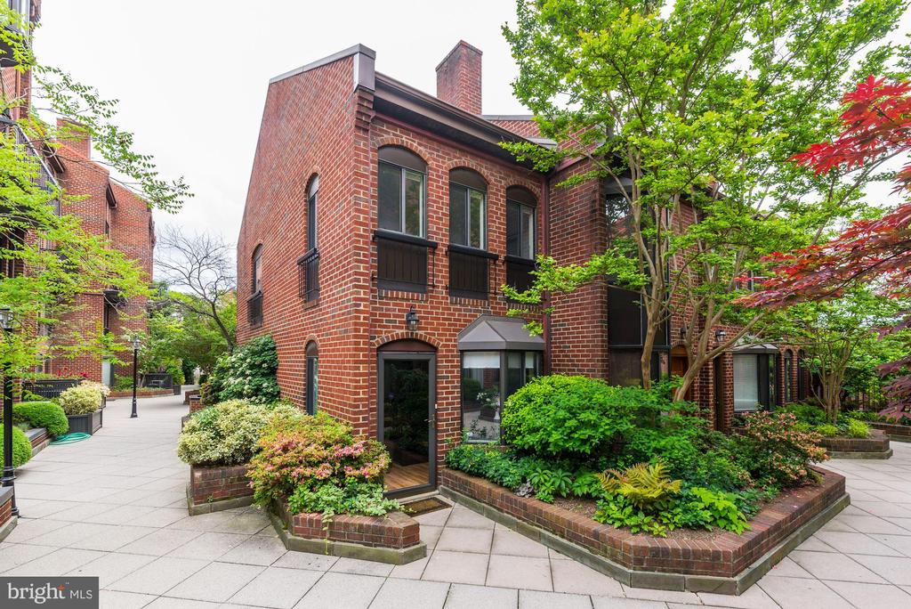 Discover this light-filled, secluded townhouse style condo in the heart of Georgetown. This 2 bed, 1.5 bath condo lives like a home, with two levels plus an attic and no units above it or below it. Being an end unit, it gets abundant light throughout and looks onto a lush courtyard. The first floor boasts manufactured hardwood floors, bay windows, a wood-burning fireplace, and an updated kitchen with quartz countertops and slate floor. The Paper Mill community is pet friendly, has underground secured parking and a pool as well as onsite management and security. It is steps from Grace Street with Grace Street Coffee, Dog Tag Bakery, Chaia Tacos and much more as well as Georgetown~s Waterfront Park and restaurants, The Potomac Boathouse, C&O Canal, and the Capital Crescent Trail. It~s conveniently located from the circulator bus and easy to get to downtown DC, Virginia, or Maryland.