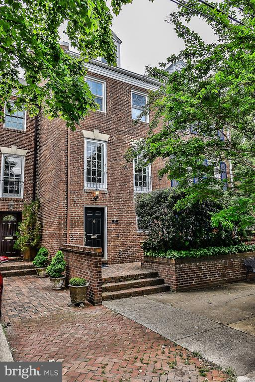 This is your opportunity to enjoy the lifestyle of Old Town Alexandria and make this wonderful home your dream home!  Charming brick townhome with over 2,700 s.f. of light-filled space ** Four levels of finished space with 3 bedrooms and 3.5 bath ** Beautiful and newly refinished hardwood floors throughout ** Entry foyer with exposed brick wall and slate floor ** First floor office/library ** Living room with brick fireplace, wet bar and French doors to patio ** Great kitchen and family room combo with brick fireplace and French doors overlooking patio ** Separate formal dining room ** Three generous bedrooms with ample closet space **PDS to floored attic for storage ** Charming deep brick patio ** Freshly painted throughout ** One off street parking space  in rear ** Short walk to the shops, restaurants and riverfront parks of oOld Town!  OPEN SUNDAY MAY 26 from 1:00 to 4:00.  Don't miss it!