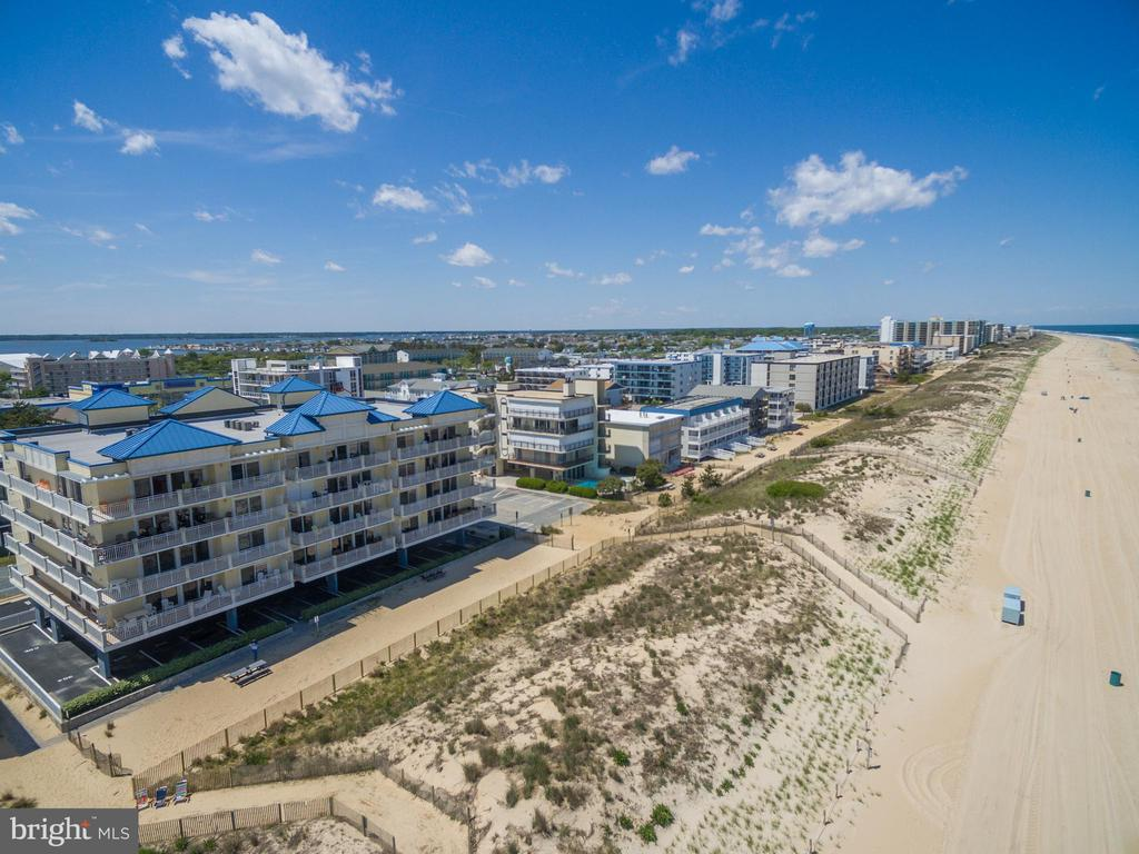 The Shark Finn oceanfront condominium is the most impressive luxury low-rise boutique condo building on the beach! Enjoy unobstructed oceanfront views and abundant natural light in this top 4th floor southeast corner end unit located on 125th in North Ocean City, Maryland. This is a rare opportunity to purchase almost 3,000 sq. feet, 4 bedrooms and 3 1/2 bathrooms as condos of this caliber rarely come on the market. Featuring an oceanfront primary bedroom, wrap-around balcony for outdoor entertaining, open concept floor plan, custom cabinetry, granite countertops, wet bar, gas fireplace, and ceramic tile flooring. Fully furnished turnkey move-in ready with excellent rental income potential. This unit has never been rented and is seldom used.