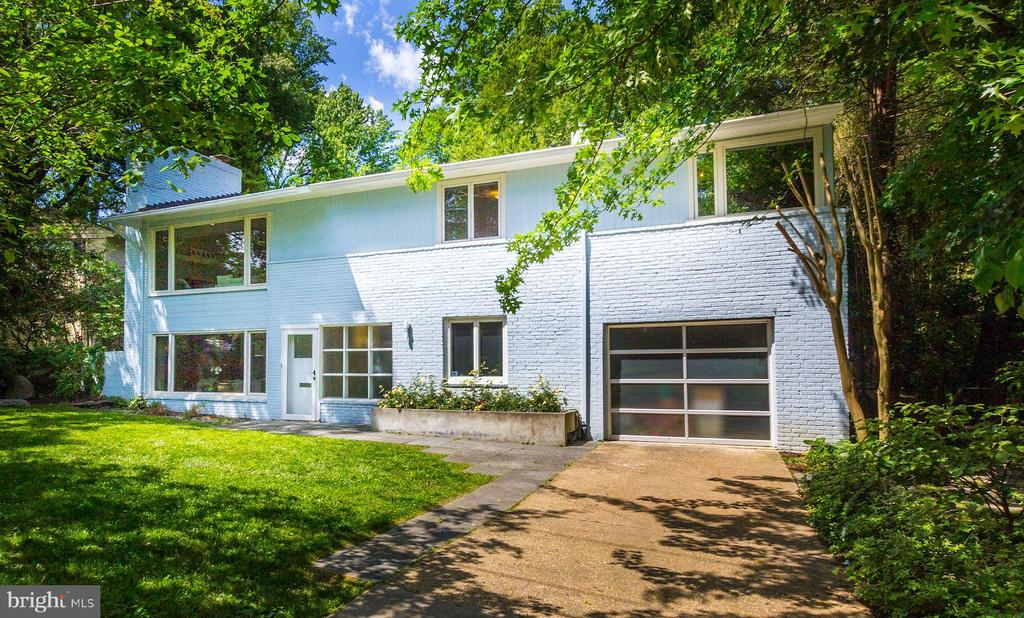 New Price, New Roof. Architectural Mid-Century Modern Masterpiece. Walk to sought after Wood Acres Elementary, Walt Whitman Cluster. This impeccable 4BR, 3BA High Point Neighborhood Mid-Century Modern home in Bethesda features significantrenovations and upgrades including $200,000 in upgrades. Andreas Charalambous designed the renovation. Slate walkway leadsto welcoming Foyer. Spacious living spaces and dining areas with ebony hardwood floors, expansive picture windows. The LivingRoom currently features a grand piano and wood gas fireplace. The dining area overlooks large fenced in backyard with garden andwater feature. Open all long doors to step out onto the beckoning terrace. What a great place for al fresco dining opportunities.Main Level: Features stunning gourmet Poggen Pohl kitchen with Miele gas and electric stove, Sub Zero refrigerator, Fisher &Paykel double dishwasher and Miele oven. The kitchen pantry is ample and organized with convenience in mind and numerousdrawers and cabinets on both sides of the island. Two front generously sized bedrooms with ample closets. Hall Full Shower/TubBath. The Master Bedroom has room for a King Size Bed. It has double wide sized closets. The attached Master Bathroom featuresShower Bath.Lower Level: Finished Lower Level has a Family Room with numerous built-in Bookcases. Large Laundry Area has Washer andDryer and set tub, ample storage area. There is a Full Bath with Shower Enclosure. Extra Refrigerator. Access door to large one cargarage, and Fourth Bedroom, Den or Office space with built-in and closet. This room could be used as additional Bedroom.Exterior: Pretty landscaped front yard with annual and perennial flowers and bushes. Two tandem parking off street parkingspaces and easily available street parking.Features: This home is in well-regarded Walt Whitman High cluster including coveted Pyle Middle and Wood Acres Elementary.Close to Clara Barton Highway, 495, access to Virginia via Key Bridge and George Washington P