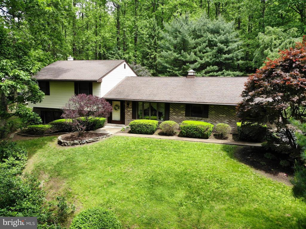 Professional photos to be uploaded 5/21 - Park like setting!! Enjoy beautiful sunsets from your vantage point on this lovely 1.88 acre wooded lot.  Custom built  2300+ sf multi level has been meticulously cared for by its owners.  Recent roof & HVAC,  new 200 amp panel back up generator ready just to name a few!   Spacious 26 handle cherry kitchen with breakfast area, island & new bosch dishwasher open dining area with patio doors to the sunroom that overlooks the amazing private back yard.  Spacious living room to watch those amazing sunsets or the view for miles! Lower level features sprawling family room with gas stove & patio doors, the laundry with laundry tub & half bath finish out this space, huge storage room in lowest level.   Oversized two car garage with another laundry sink & attic access.  Outside is absolute paradise!  1.88 acres of wooded privacy with a surprise flat yard tucked in the woods!  Perfect for corn hole, volley ball , quoits & boccie, gather on the huge back deck with covered pergola for bar-b-ques and enjoy the peacefulness of this property!  Conveniently located minutes from 222, quick commute to Reading, Lancaster, Morgantown.   This home is ready to welcome you home!!