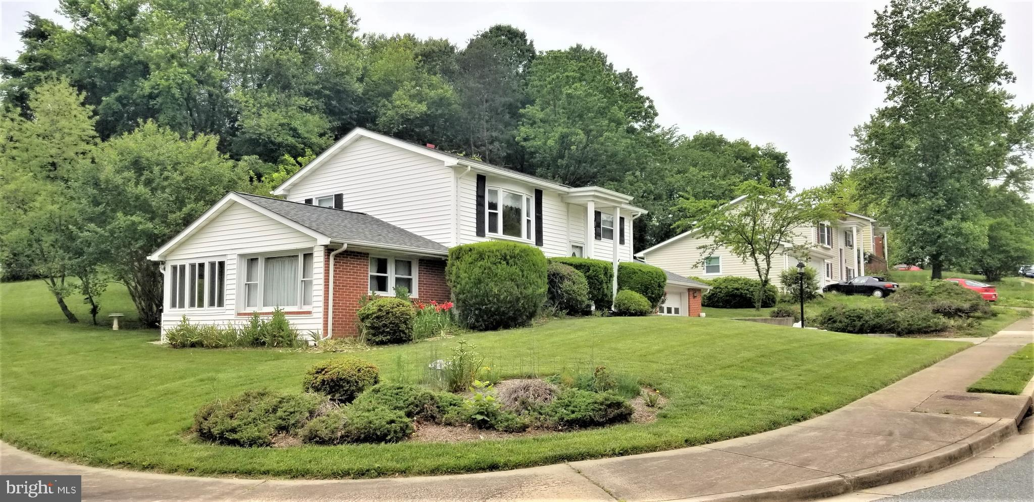 OFFER submission deadline is 8pm Tue 5/20. Please submit Highest and Best by deadline.   This wonderful home is being sold by the original owner. It has been lovingly maintained and is just waiting for its new owner's updates.  Gorgeous corner lot in great commuter location...ez access to I95 and commuter lots. 3 bedrooms and 2 full baths. Separate dining room, large living AND family rooms.  New roof, heat, and water heater.