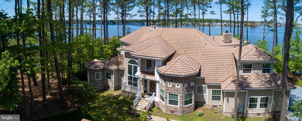 If you are looking for the most compelling property in Ocean Pines- look no further!!! Privately and naturally nestled on a nearly 3 acre waterfront lot with panoramic and unobstructed views of Ocean Pines/Ocean City. The property features 800 feet of natural shoreline complete with 200 feet of sand beaches and a 250' pier. 4 spacious bedrooms with astonishing views alongside 4 full baths. 1st floor master bedroom combined with sitting area and sunroom. Elegant marble countertops throughout. Concrete tile roof is guaranteed for life. This home radiates sophistication and elevated creativity. So tastefully done it merges real estate and art. Photos of the interior to follow. Call today for more information!