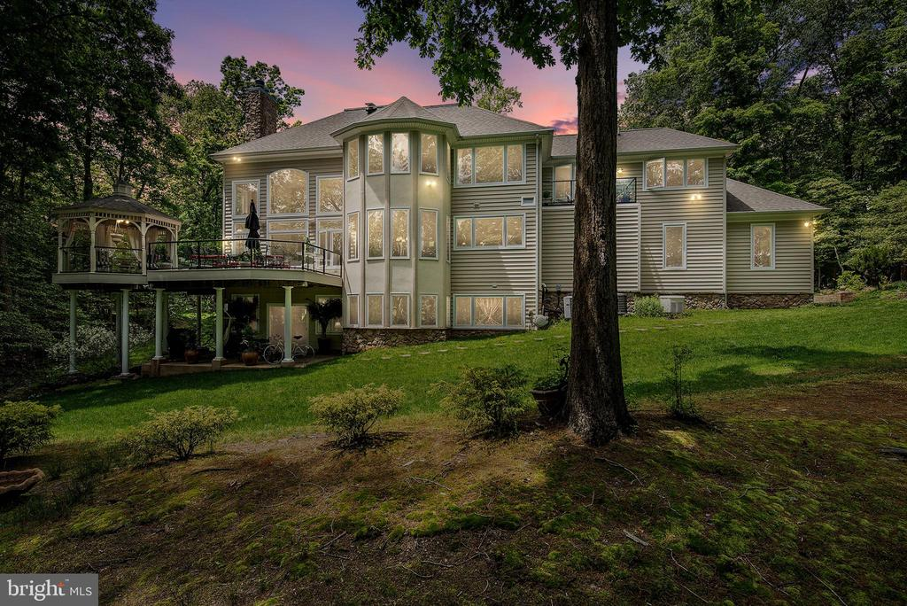 Enjoy waterfront living in this custom-built Baldwin home on a 2.49 acre lot located just off the Magothy River.   Situated on Blackhole Creek with 660~ of water frontage, a pier accommodating 4 boats with 4~ MLW and a 12.5K boat lift. The home is ideally located to ensure quick access to the Magothy River for the powerboating enthusiast. This peaceful setting is known as ~Eagle Cove~ for the eagles that are frequently seen gliding over this point of land.The first level features a gourmet kitchen with all Viking Professional series appliances to include a six-burner gas stove with two gas ovens, a separate electric oven, a large 42~ side by side refrigerator and a wine refrigerator. Other kitchen amenities are granite countertops and custom maple cabinetry, all opening to the soaring two-story great room with stone fireplace. Kitchen, breakfast area, and great room provide a magnificent view of the water, a manicured lawn and flower beds.  There~s a formal dining room located off the kitchen for easy access when entertaining.  Gleaming hardwood floors and ceramic tile throughout the first floor. In addition, there is a home office/Study with glass front French doors on the first floor as well as a half bath.  There~s an attached three car garage and an adjacent private parking area for an additional 10+ cars.  Relax and enjoy the views from the waterside deck and heated covered gazebo.The second level occupies an expansive master suite with balcony overlooking the water and beautifully landscaped gardens. Master bath with deep soaking jetted tub, separate shower with a waterfall shower heads, double vanities with cherry cabinetry, granite tops and heated floors. In addition to the master suite, the second level has two large additional bedrooms, full bath with cherry vanity and marble sink top, and separate laundry with stackable Whirlpool Duet washer and dryer.  The fourth bedroom is located in the lower level that could also serve as an in-law/au pair suite inclu