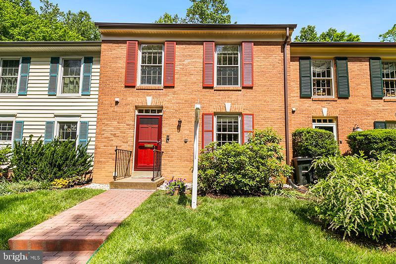 Back on market...buyer got cold feet.                          It's quiet here!!Meticulously maintained and updated brick front and rear unit backing to trees and park. A wooded retreat in TRULY MOVE-IN CONDITION. New stainless refrigerator, dishwasher, and granite in kitchen. Hardwood floors main level. Step down living room with 9' ceiling, built-ins and fireplace opens to deck and treed view. 3 bedrooms up with new carpet. Master bedroom features Juliet balcony and large closet. Walk-out lower level with rec room, 2nd masonry fireplace, full bath, and space for 4th bedroom opens to patio with fenced yard.Easy access to 95, Fairfax County Pkwy, Ft Belvoir. Easy access to VRE, short distance to trails and playground.                                Open house Sun 1-4                                                                                       Over $35, 000 in updates since 2011 new frig & D/W & granite in kitchen  2019, new carpet upper level 2019, rebuilt chimney & flashing 2019, new HVAC 2018, energy efficient water heater 2016 ;  carpet lower level 2016 GE washer, dryer 2016 roof 2011.