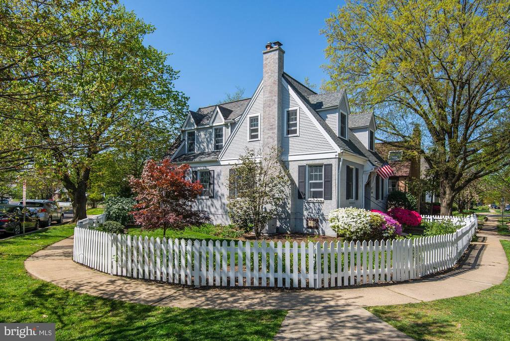 Storybook Cape Cod with a picket fence and flowering gardens. This light-filled, 3 bedroom, 3 full bathroom Lyon Village home offers all of the charm from the 1930's with today's modern amenities. Just a few blocks to Metro, Whole Foods, shops dining and 2 miles to DC.
