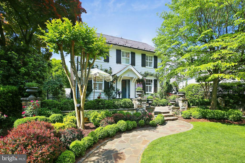 Freshly renovated Chevy Chase Village stunner. South facing, full of light with 5 new BR, 5 new BA. Front has artisanal stonework, framed by gorgeous landscaping of flowering roses, dogwood and crepe myrtle trees, and a cobblestone driveway. Backyard is flat, framed by boxwoods and other greenery, with room to play. Main level includes bright and fresh formal luxury living room, music room, dining room, and large family room addition. Plus a huge open concept space to design your dream kitchen in the heart of the house. Basement includes catering kitchen, 2nd laundry, full bath, hang-out room and king sized bedroom/guest suite. Second floor has MBR w/ en suite BA, dressing room and fireplace. Full size W/D close by for convenience. Two additional BR and hall BA on 2nd floor. Third floor has large BR for two with en suite BA, built-in window seat and shelving, and walk-in closet. Old slate roof was replaced; new one should be good for another 100 years. Sewer line to street has been replaced ~ a costly upgrade that is very important for houses this age. Beautiful copper gutters and downspouts.