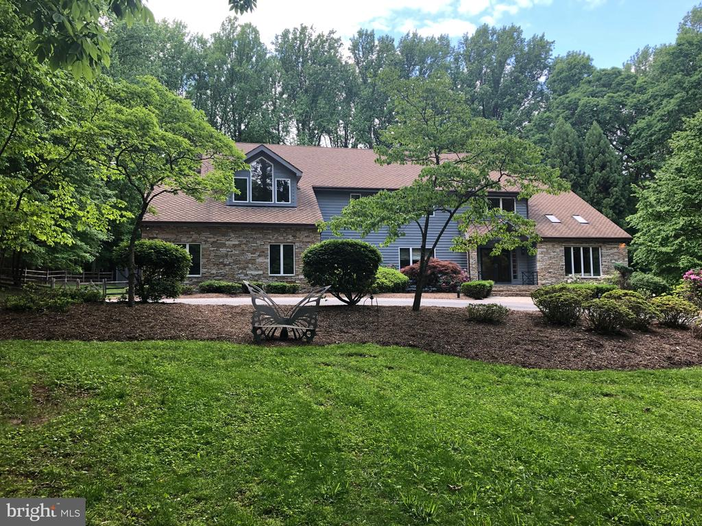 A spectacular opportunity to live in the heart of the idyllic Greenspring Valley is presented with this totally renovated stone and cedar contemporary home sited in a coveted gated community close to all the amenities of Greenspring Station and easy access to downtown Baltimore.  Located on a private drive off a picturesque cul-de-sac on more than three park-like private acres, this elegantly appointed, welcoming residence offers open spacious rooms, dramatic vaulted ceilings, and rich hardwood floors.  The center of the home is a true chef~s kitchen overlooking the large family room with a classic stone fireplace.  The impressive kitchen has a 10-foot granite island, matching stainless steel SubZero refrigerator and freezer, five burner gas cooktop, and 42-inch upper cabinets.  There is a seamless flow to the family room, open dining room, vaulted living room, office, and inviting sunroom.The upper level hosts four generously proportioned bedroom suites all with walk-in closets, and new or updated private baths.  Relish the cathedral ceiling master retreat with large sitting room and fireplace, and artfully designed new luxurious spa bath.  A finished walk-out lower level provides recreation space, a fifth bedroom and full bathroom.  Delights await as you explore the property with its landscaped grounds, in-ground pool, cathedral pool house, and IPE mahogany decking, perfectly situated in serene and natural surroundings.Note square footage does not include added sun room.