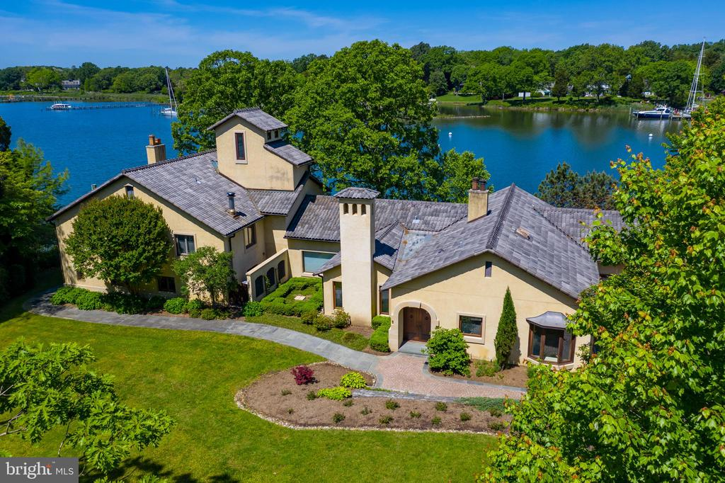 Beautiful, stately waterfront villa with awe inspiring views, multi-slip commercial grade pier and boathouse. This 3 bedroom 3 1/2 bath home boasts an old world inspired kitchen w/ custom cabinetry, granite counters and lots of attention to detail, living room has expansive views through floor to ceiling windows, library with fireplace & built-ins, sunroom boasts old world charm with columns and architecturally detailed ceiling. The spacious master bedroom has custom designed closet and oversized ensuite bathroom. Detached 3 car garage features a rec room with massive exposed trusses and half bath. Enjoy all that waterfront living has to offer, fishing, crabbing, boating and enjoying all the wildlife. Welcome Home!