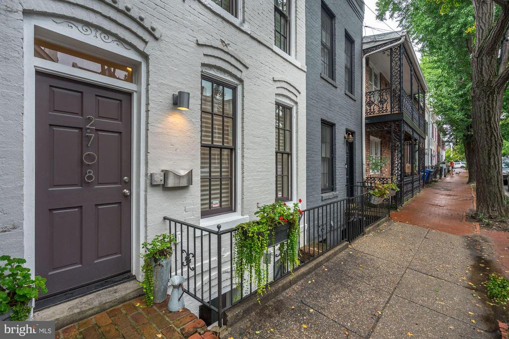 Modern Living in Georgetown's East Village! This 4 level Federal townhome features 3 Bedrooms 3 full BA, 2 half BA, main level living /dining room w/ fireplace, huge kitchen w/ fireplace & walkout flagstone garden oasis w/ water feature. A separate entrance for a lower level in-law suite or income unit. Located next to Rose Park, Shopping, Dining & Nightlife just .3 miles to Farragut West Metro.
