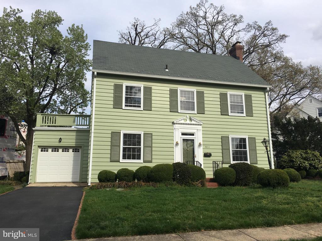 Classic Lyon Village Colonial with attached garage in Arlington, Virginia on one of the most beautiful streets in Lyon Village.  Corner lot on a quiet street.  3 bedrooms, 3 bathrooms, lower level family room, enclosed sunroom that opens into a private  backyard with mature landscaping.  First and Second level are all wood floors, lower level has new carpet.  Plenty of storage in basement and in third floor attic.  Lyon Village offers the Lyon Village Park and Playground with tennis courts and basketball courts.  Walking distance to Clarendon, Metro and DC. Owner Agent