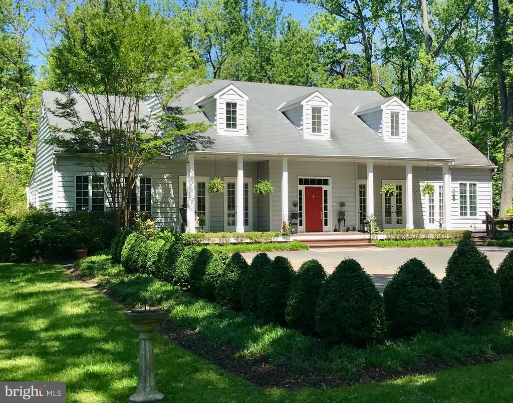 Located on a private lane in Greenspring Valley, this porch front cape cod is bright and cheery with an open floor plan, vaulted ceilings and more than 3000 square feet of above grade living space.  The first floor master suite includes a walk in California closet and a large sitting/dressing room.  The kitchen is updated with granite counters, wood floors and recessed lighting.  You'll want to spend most of your time on the covered blue stone patio that boasts an outdoor kitchen with granite countertops, a Vermont Castings Signature Series built in grill, custom wood cabinetry, and a wood burning fireplace with a large brick hearth and a custom stone surround.  Overlooking a private stream and beautiful landscaping!