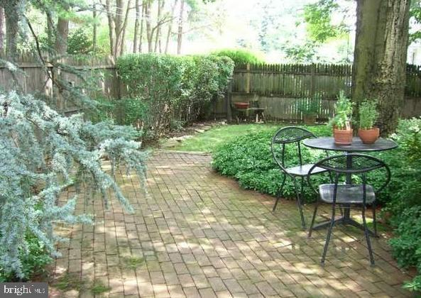 Set on a tree lined private drive perched above Haverford Rd, sits a Sunlit Cape Cod Home on a 1/4 acre. The fenced in gardens & patios are welcoming and relaxing perfect for morning coffee and outdoor dining. This home is surrounded by mature plantings and set in a sought after neighborhood of beautiful homes, just steps to the nearby park. Through the sliding glass doors enter the Designer eat-in kitchen with Granite tops, limestone floors & backsplash, stainless gas cooktop & hood, under cabinet lighting & custom maple cabinetry with breakfast table. Highlights include: Newly renovated powder room, refinished hardwood floors, newer windows throughout the home, newer hvac. Off the kitchen is the Spacious Formal dining room   with convenient powder room, the dining room opens to the  living room. The living room opens to the expansive sunroom/family room that spans the length of the house with vaulted ceilings, skylights, and walls of windows a perfect sunlit space for entertaining and relaxing allowing the sunshine to pour in.  A office/study with built in cabinets (original train conductors cabinets) complete this level. The second floor has 3 bedrooms and a renovated center hall bath, with a soaking tub, large mirror & vanity. The Spacious primary bedroom is sunlit and has 2 closets, one a walk-in.  Two additional bedrooms (you must walk through bedroom 2 to get to the third bedroom) one with large walk-in closet, complete this level.  Spacious newly finished basement with tiled floor and recessed lighting, spacious game room, workshop & laundry room. Walk just across the street to Wynnewood Valley Park, walk to LM penn wynne elementary school, dining, & shopping and a around the corner from the train and Wholefoods. Easy commute to center city and close to public transportation. Award-winning Lower Merion Schools. - HOME INSPECTION AVAILABLE CONTACT AGENT