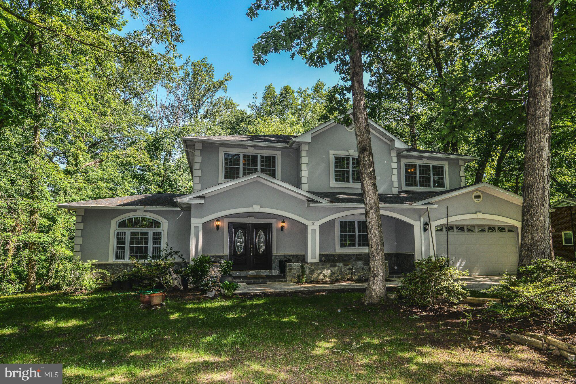 ** OPEN HOUSE SUNDAY 9.1.19 from 1-4**Custom built in 2008, this luxury home sitting on nearly an acre of wooded privacy and backing up to a Northern Virginia Conservation Area, offers spectacular views in all directions. With 3 beautifully finished levels spanning approximately 4000 square feet, this home offers plenty of space inside and out. The main level features Brazilian Cherry floors throughout, formal living room with fireplace, large formal dining room, along with your chef's kitchen and separate family room with access to the deck. Additionally, the main level includes a library/office and a main-level bedroom perfect as an au-pair or mother-in-law suite. Upstairs you'll find 5 bedrooms with all new carpet and huge closets, including the master suite with a separate soaking Jacuzzi tub in it's spa-like bath. There are 2 additional bathrooms, complete with ceramic tile and granite counters, upstairs as well. The very spacious walk out lower level houses 2 more bedrooms, huge storage rooms (both being used for storage so please excuse the mess), wet bar, family room and another full bath!  The lower level has brand new plush carpet.  Contracts will be considered and reviewed immediately upon receipt.