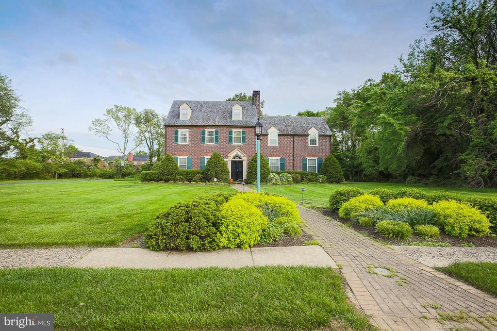 Custom built stately brick home in the Fallstaff neighborhood.  Grand entrance foyer, spiral staircases, 6 bedrooms 5.5 baths, enlarged updated kitchen, living room with fireplace, 1st floor den with fireplace, hand painted wood floors, enclosed sun room, patio, beautiful .73 acre lot, attached garage.