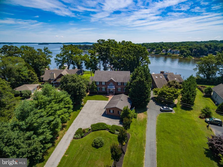 REL ESTATE AUCTION ON SITE THURSDAY, JUNE 27, 2019 AT 12:00 NOON. List price is suggested opening bid only. $100,000 cashier's check deposit required to bid. Spectacular waterfront home on Magothy River. 5,000+ square feet of finished area. Deep water pier and boat lift. Please contact listing broker's office for full terms, bidder pre-registration form and property details.