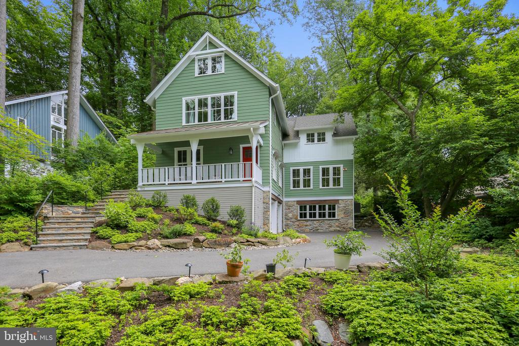 1st Open Saturday, May 25th 1-4 pm and Sunday, May 26th 1-3 pm! Extraordinary custom designed New England style farmhouse in the highly sought-after neighborhood of Glen Echo Heights, on a gorgeous 0.36 acre lot. This five bedroom, four and a half bathroom home features approximately 5,000 square feet of living space on four finished levels. This sophisticated home is replete with light-filled interior spaces while blending a rustic farmhouse inspired design with the natural landscape. Elegant upscale finishes and fine details including: reclaimed Heart of Pine flooring, coffered and beamed ceilings, crown molding, wainscot molding, tray ceilings, French doors, custom built-ins, two gas fireplaces, and an outstanding chef~s kitchen. The main level boasts a welcoming foyer, an inviting living room / office, an elegant formal dining room, and an incredible chef~s kitchen with a sizeable marble center island which opens to an exceptional sun-drenched great room. The main level is complete with a mudroom, a powder room, and a delightful screened porch. Upstairs are oversized hallways, upper level laundry, and four en-suite bedrooms with three full bathrooms, including a luxurious owner~s suite with a decadent private bathroom. The finished walk-out lower level features a spacious recreation room with fantastic natural light, a fifth bedroom, a full bathroom, a second mudroom, and a two-car garage. Unparalleled quality craftsmanship and exquisite finishes ~ all on a premier 15,538 square foot lot with a delightful front porch, a charming rear patio, a backyard deck, and a screened porch! Great location ~ close to the Chesapeake and Ohio Canal Towpath, Glen Echo Park, and Downtown Bethesda! Easy access to the Macarthur Boulevard, Massachusetts Avenue, Clara Barton Parkway, the GW Parkway, Chain Bridge, I-495, and minutes to DC.Schools: Wood Acres Elementary School, Thomas W. Pyle Middle School, and Walt Whitman High School