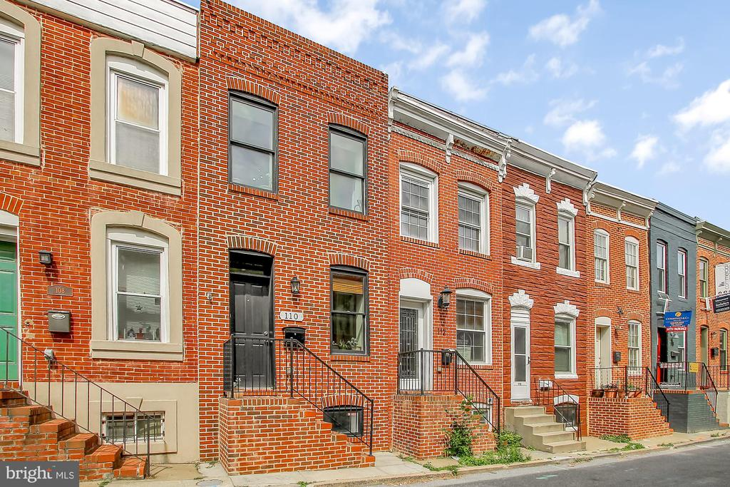 Come check out this beautiful rowhome in Patterson Park! LR w/ hw floors, exposed brick, tray ceiling, & dec fireplace, half bath, designer kitchen w/ breakfast bar, granite counters, & ss appliances, 2 bedrooms & 1 full bath on upper level, 2nd level rear deck w/ privacy fence, unfinished basement for storage & 1 car parking pad!