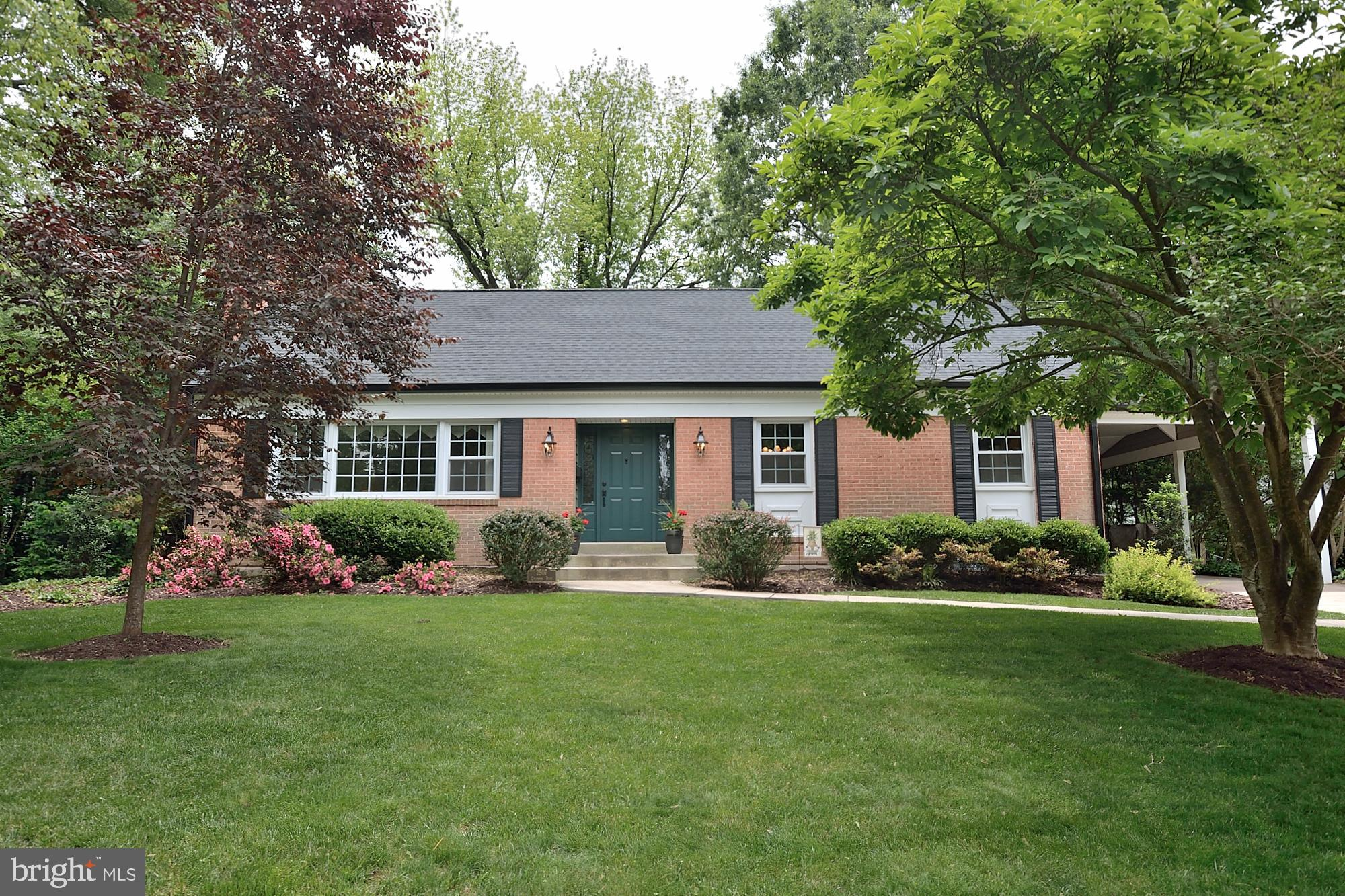 Largest Gramercy model with bonus family room off kitchen and screened porch. All major systems          recently updated. Fresh paint throughout*brand new stainless steel kitchen appliances and light quartz countertop*New roof & siding in 2018* Hardwood floors throughout main & upper level * New AC/Furnace 2018*Washer/Dryer 2017* Chimney liner and damper 2016* BDry Waterproofing system and brand new carpet in Lower Level 2019. Large storage/utility room/mud room for workshop walks out to back yard.  Upper level walk in attic   storage. Carport and off street parking. Meticulously landscaped lot with patio for entertaining and storage shed.