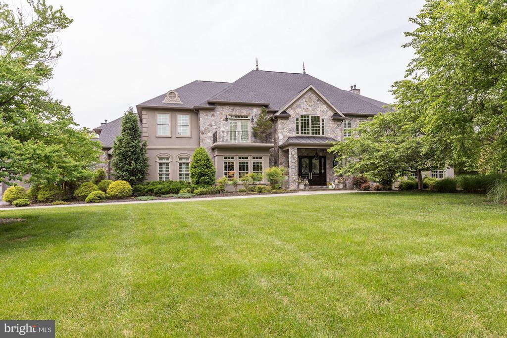 This spectacular estate is set on 5ac in the subdivision of Virginia Run. The Home is more comparable to homes in Clifton or Great Falls. The estate consists of a main house and guesthouse and comes w/ a 4 car garage. Great for entertaining w/ Pool, a 1st level movie theater and a billiards room. As you enter the grand 2-story foyer of black and white checkered marble, it is immediately apparent how high quality the house is. To the right you'll find a parlor that has a marble border w/ inlaid carpet, triple crown on the triple tray ceiling. To the left is your formal dining room w/ a black marble floor and triple tray ceiling w/ built-in Habersham butler and a matching fireplace Mantle. On the other side of the dining room sits a pocket door that opens up into a butler~s pantry that is large enough to have a table. It has a ceramic tile that looks like wood so it~s practical and is great for a caterer~s room. As you go straight thru the foyer you enter an awe-inspiring 2-story great room w/ a coffered ceiling and Schonbek chandelier and walls of glass palladium windows and a massive precast fireplace. Beside this great room, you will find the hearth room w/ fireplace, all of this is open to the magnificent kitchen. The Habersham cabinets are exquisite, the detail and millwork is nothing short of art. This kitchen is not just a pretty face, it~s also functional w/ 2 center islands of workspace, a butcher block countertop, 2 Subzero refrigerators that are hidden cabinetry, a Wolf range w/ 2 ovens, pot filler and a 3rd oven under the counter plus the microwave. There is even a Miele cappuccino machine. Behind the kitchen, you'll find a Pantry that in itself is a beautiful room, well-organized w/ Habersham cabinets. To the back of the house open to the kitchen, you will find a bright morning room w/ fireplace that opens onto a covered porch and walks out to the rear yard and pool area. Off the mudroom room when you come in from your 4-car garage is a special dog room w