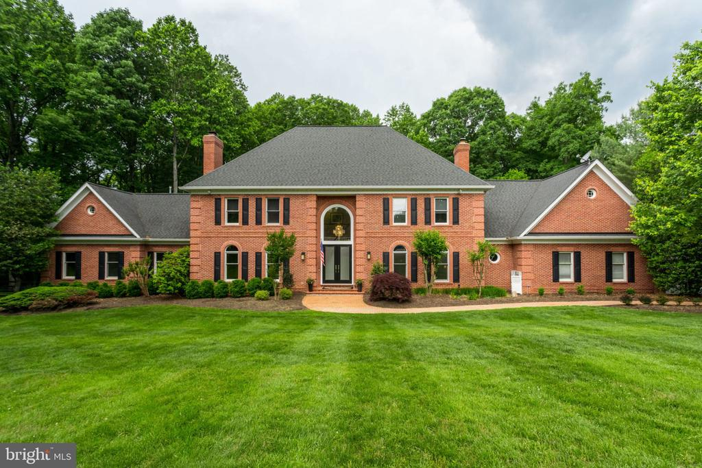 HUGE PRICE ADJUSTMENT for this one of a kind find featuring HANDICAP ACCESSIBILITY throughout the main level with an au-pair suite to include a sitting room and a brand new (handicap equipped) spa bath!This Custom Contemporary Colonial offers 6 beds/5.5 baths of expansive moldings,built-ins, hardwoods, Embassy sized rooms, A BRAND-NEW Gourmet kitchen, a luxurious master suite with custom closets and spa bath,  4 sides Brick with a 3 car garage and a spacious mud room and Designer window coverings throughout.   A spacious walk-out lower level with over 2000 sq.ft that is complete with high end features to include a fitness center w/ sauna,hobby room, large recreation media room with surround sound, wet bar, whole house generator, surround sound SONOS system and wine cellar!Beautifully sited on a very private  cul-de-sac overlooking 2+ acres of manicured gardens and ornamental trees! Privacy abounds.... This home is truly unique on every level! You do not want to miss this amazing home!!