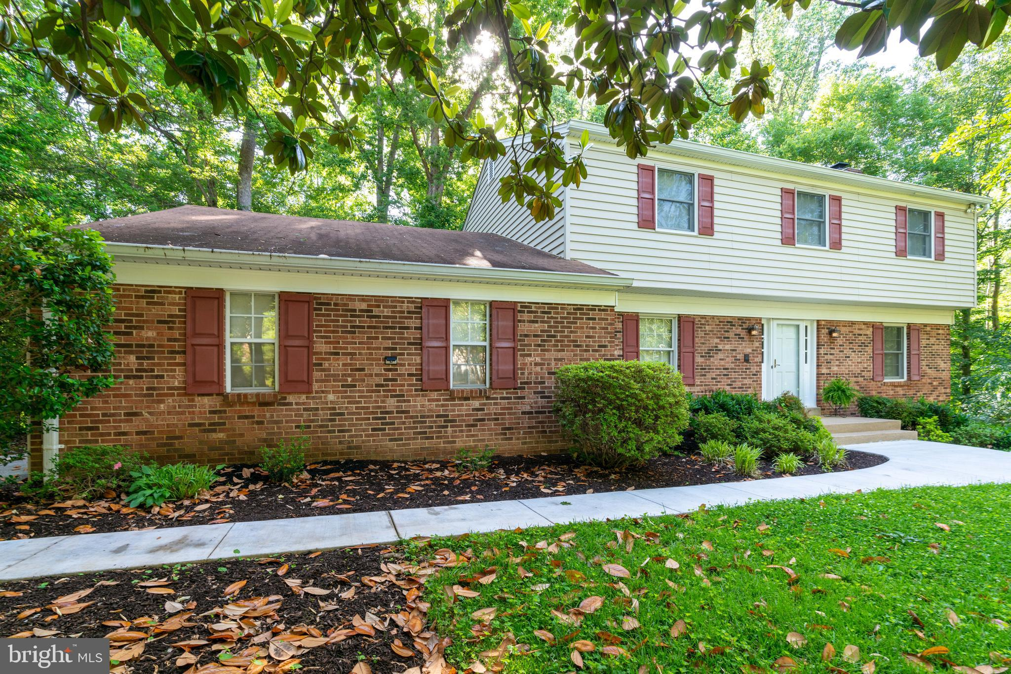 Looking for a lovely colonial on a private cul-de-sac that feeds into South County? Look no further.  Freshly painted, refinished hardwoods, newer carpet and lots of updates.  Open kitchen, nook, family room floor plan.  Relax in front of the wood fireplace under the vaulted ceilings in the family room.  Fabulous walk-out lower level with wet bar and gas fireplace.Backs to Pohick Creek and Cross County Trail.  Side entry garage and fenced back yard with room to expand. Prime location ~ close to nature parks & trails, close to military bases and convenient for commuters.
