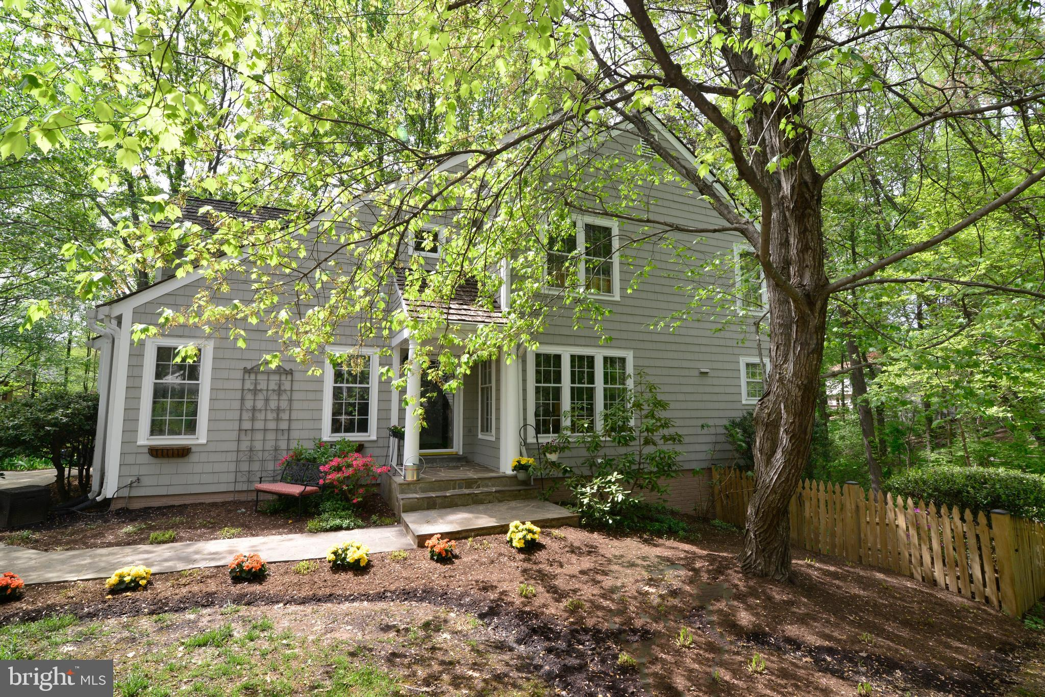 Absolutely Charming, Updated, 4 Bedrooms, 3.5 Baths and Located in an Adorable Cluster of Homes in the Heart of North Reston. Year Round Privacy Abounds at the End of the Cul-de-Sac While Backing to Lush Woods with Paved Walking Trails. Walls of Windows, Soaring Ceilings and Skylights Enhance the Open Floor Plan. The Main Level Comprises Gleaming Hardwoods, Spacious Living Room, Cozy Family Room with Wood Burning Fireplace and Access to Peaceful Deck. Remodeled Kitchen Comprises Custom Cabinetry, Glass Tiled Backsplash, Under Cabinet Lighting, Granite, Stainless Steel Appliances. The Upper Level Master Bedroom Suite Has Two Closets and Spa-Like Bath. Two Additional Bedrooms, Full Bath, Rarely Available Upper Laundry, and Dramatic 2-Story Overlook Round Out the Upper Level. The Walk-Out Lower Level with New Flooring Boasts Family Room with French Doors to Expansive Lower Deck, Legal 4th Bedroom with Sunny Window, Full Bath, Bonus Room.  Professionally Landscaped with Gorgeous Blooming Plants. All This and Located Just One Block from Reston's North Point Center with Shopping, Restaurants, Entertainment. Walk to Pools, Tennis, Reston's Trails. Commuters Dream Location! Just One Mile to Reston Town Center, and Minutes to Metro, Route 7, Toll Road, Greenway. Updates Include:  2004 New Roof, 2005 New Furnace, 2015 Fully Remodeled Kitchen with New Appliances, Remodeled Lower Level, 2016 New HVAC, Water Heater, Skylights, 2019 Refinished Hardwoods, New Carpet, New Fixtures, Whole House Painted, Newly Improved Bathrooms~