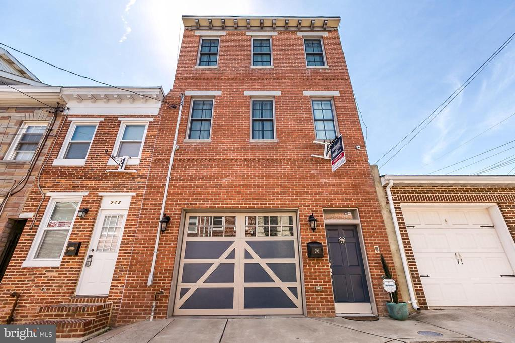 1-of-a-kind 20ft+ wide Garage Town Home on quiet street in Fells Point! Seller will provide 2-year lease for 2nd garage space right next door! 2700sqft+! Spacious main-level includes upgraded & beautiful eat-in kitchen w/granite island, huge Living room & dining room with wet bar, powder room & 1 of 2 decks. Enjoy a gourmet kitchen with huge kitchen island (seating for 6+) and double pantries. 3 bedrooms spacious bedrooms with great closet space, 3 full spa-like baths, Two-person shower in master bathroom, hardwoods throughout, on-demand hot water, intercom, neutral paint colors. Enjoy in floor heat in lower level bedroom and bathroom. 2 zone HVAC. Huge & spacious garage. Two large outdoor decks with Trex decking. New roof in 2018. Current owners added a kitchen buffet & electric fireplace insert in lower level bedroom. Enjoy whole house security system and wifi connectivity/monitoring: four exterior cameras, electronic keypad, etc. The kitchen cabinets (two-tone) and backsplash were updated in 2019. Tons of storage space on all levels and large walk-in closets in two bedrooms. You cannot find a better home with excellent walkability to everything! This meticulously maintained & freshly painted home is a must see!