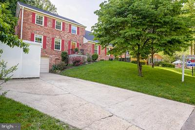Rare main level bedroom and bath PLUS 5 additonal bedrooms and 2 additonal bathrooms! Chapel square colonial with 6 br 3 ba tucked inthe rear of the neighborhood. Garage and driveway parking. Slate walkway. Tons of living space!!!! Large rooms: main level office, living room, dining room w bay window, large eat in kitchen w new ss appliances, all open to a HUGE sunroom patio plus a family room with beams and raised hearth fireplace! Upper level has 5 bedrooms and 2 new bathrooms. Hardwood on 2 levels. New roof, windows, 2 of bathrooms, HVAC 6 years old. Beautiful yard!