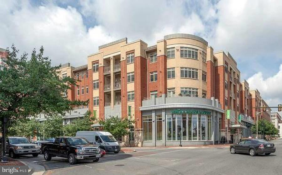 This unit is close to everything: 1 Block to the King Street Metro Station, parks across the street, bike trails starting at intersection, a plethora of restaurants on King St and best of all there is a Whole Foods INSIDE THE BUILDING! This is a spacious 1 bedroom with 1 full bathroom with an open floor plan and with a large walk-in closet. This high-end luxury unit with 10ft high ceilings, gleaming hardwood floors, a gourmet kitchen with granite counter tops and stainless steel appliances. The French Patio Doors lead you to a private deck that faces the building's courtyard. High-Efficiency washer/dryer is located inside the unit. The building has an on-site concierge, outdoor courtyard with gas grills, business center, and full-service fitness center. Indoor garage parking and water, gas and trash removal utilities are all included!
