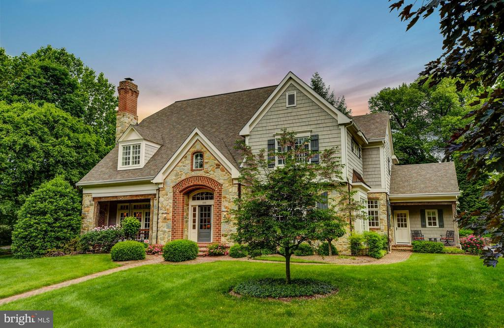 This meticulously maintained, custom built French Country home is nestled on a private cul-du-sac, in a lush park-like neighborhood that borders Elkridge Country Club and Lake Roland. Centrally located inside the Baltimore 695 Beltway, this Baltimore County home is within 20 minutes of downtown Baltimore and within 15 minutes from the primary cluster of private/public schools and universities. Access to the Beltway is within 15 minutes. The professional landscaping with mature trees and perennials is designed to bloom almost year-round. French doors and tall multi-pane windows with transoms are located throughout the first floor allowing light to flow throughout the home. The open floor plan flows into a brick/stone patio is ideal for family living and entertaining. Created by premier builder, Melvin Benhoff, this exquisite home includes his signature arches, bull-nose corners, wide crown moldings, Crystal light fixtures, 12-foot main floor ceilings, custom built-ins and stone fireplace. 4 bedrooms, 3 baths and 2 half baths includes au pair suite designed to code.