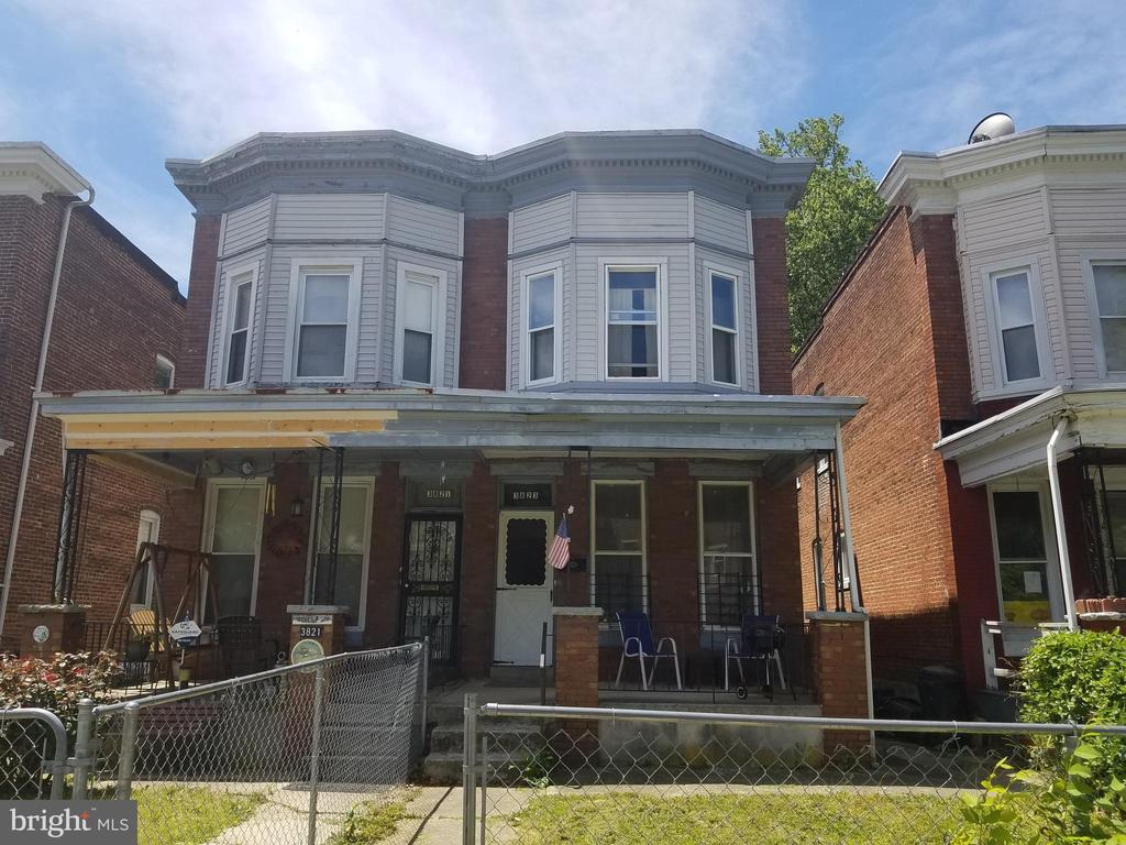 Brick porch front house on Baltimore's historic west side. 3 bedrooms and 2 full baths with flush in basement (bathroom on each level). Wood floors throughout. Skylight, stained glass, claw foot tub, original woodwork and moldings, high ceilings. Double pane vinyl windows (5 years old). Brand new baseboard heat. Recently updated kitchen with appliances only 2 years old. Updated electric and fixtures. Exterior trim just painted. Possible 4th bedroom in basement. Parquet floor with inlay. New gas heater in living room for added comfort. Porch on rear 1st floor and screened porch off 2nd floor bedroom. Large fenced yard backs up to beautiful Leakin Park. Convenient to busline. Near shopping, schools, community center. This house has it all. Updated for modern living yet maintains its original charm. Well maintained and ready to move in at a great price!