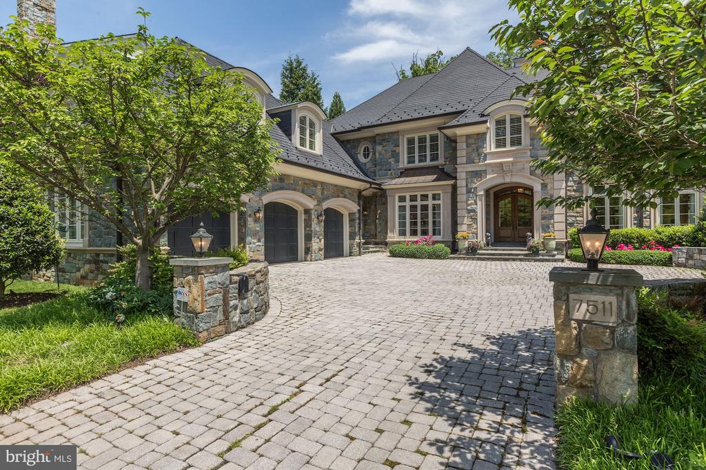 Welcome to 7511 Hampden Lane, one of the most impressive homes in the sought-after neighborhood of Edgemoor. Meticulously designed by Glenn Fong and custom built by Jeffco, this 12,000+ square foot manse is perfectly sited on a flat, private half-acre lot, just a stone's throw to restaurants, shops and more. A sprawling Belgian block custom driveway welcomes you and opens to a generous motor court with 3 garage bays. The oversized recessed flagstone entry boasts 2 glass and mahogany arched doors opening to a stunning and dramatic double entry foyer with limestone flooring and spectacular curved staircase with custom-designed hand-forged iron railing. Each room is generously proportioned, with eleven foot ceilings, floor to ceiling custom windows and an abundance of natural light. English gardens, stone terraces and flat green space await the buyer in the rear of the property. This distinctive and beautiful residence is an entertainer's dream and one any upper-bracket buyer would be proud to call their forever home.
