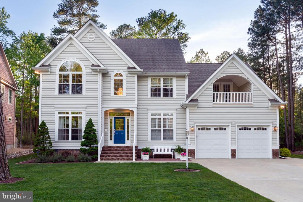 """Ready to be WOWED by this """"Stonebrook"""" model from Lighthouse Homes. This custom house was built in 2003 and has had only 1 owner. 4 beds, 3.5 baths on a secluded ACRE LOT IN THE PINES!! With access to your own private boat dock, just walk across the street and take a ride out to the main bays of Ocean City. With all brand new, high end LG stainless steel appliances you can't go wrong with this stunning open kitchen. Tired of sitting inside? Take some time on the screened in back porch, a fully secluded 3 seasons room equipped with 2 flat screen TV's perfect for watching the big game on the back deck! This property backs up to 21 acres of the Whitetail Sanctuary making it truly a one of a kind home in Ocean Pines, don't miss your shot! Other upgrades and accessories include an in-ground lawn irrigation system, electric dog fence, Hunter Douglas remote shades in the living room, deeded 300 ft boat dock with riparian rights, 8 person Hawkeye outdoor hot tub, Heat-N-Glo fireplace, the list goes on and on. Call today to see this home. FYI, this home DOES NOT feature a 1st floor master bedroom."""