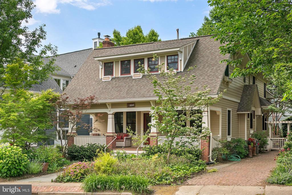 How not to fall in love with this Hemphill & Associates renovation of a classic Craftsman in Lyon Village? A wide front porch with room for reclining, visiting and enjoying welcomes you, as does the front garden. Stepping inside one is greeted by classic architectural features in a residence that saw a total renovation in 2014! The renovation brought new electrical, new plumbing, new systems, new windows, new roof ... but it is the results that are striking. The home provides a sanctuary from the hustle of the easy urban lifestyle at one's doorstep. The owners spared no expense in the renovation: from the 4 skylights; the vintage high-end glass door knobs; custom antique glass from Germany; antique teak columns from a temple in India; handmade tiles used in the living room, butler's pantry, kitchen, and bathroom.  The upper level bathrooms enjoy limestone floors; and the master bath, main level bath, kitchen and adjoining great room enjoy underfloor heating. The master bath provides a shower with bench (steam shower), freestanding slipper tub and a separate toilet room. The extensive landscaping, upper level balcony, and absolutely amazing kitchen with cathedral ceilings await review - assured five stars.