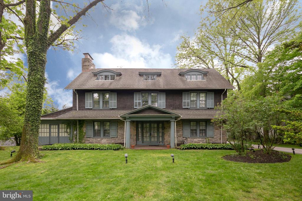 Charming 3 story colonial built at the turn of the      century on a beautifully landscaped lot in sought       after Haverford.  An inviting reception hall with oak flooring throughout leads to a spacious dining room offering lots of natural light. The formal living room features a wood burning fireplace, an abundance of windows, and connects to a fabulous brick floored sun porch. The gourmet kitchen has been updated with all new stainless steel appliances, Kountry Kraft cabinetry, quartz countertops, and a large island.  A Butler's Pantry off the kitchen  with dishwasher, sink, ice maker, additional storage, and a half bath complete the first floor. A gracious staircase leads to the second floor where you will find four multi-functional bedrooms and three full baths.  Additional closet space, a laundry room, and small balcony are also  found on this floor. On the third floor you will find two bedrooms and a hall bath with soaking tub. The exterior offers a large 2 car detached garage, extensive hardscaping, front and rear yards, a private hot tub, and an ecologically sound rain garden.  Meticulously maintained and and well cared for, this home is convenient to both the Bryn Mawr and Haverford train stations, Haverford Square and walking trails.
