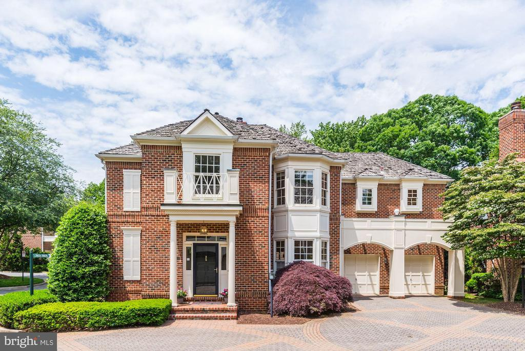 You'll love coming home to The Gates at Avenel!  This all brick 4,000 square foot colonial home features some views of TPC Potomac at Avenel Farm.  It features hardwood floors on the main and upper levels and has 4 bedrooms, 3 1/2 baths, plus a two sided fireplace for the living room and family room.  The kitchen features stainless appliances, double wall ovens, an island, plus room for a table.  The master bedroom offers two closets, and the master bath features a shower and soaking tub.  Downstairs you will find the media room with a wet bar and the second family room.  Many rooms have built-in bookshelves.  Also, the home has lots of storage plus a two car garage.  The HOA provides the pool, tennis courts, parks, landscaping, snow removal, and so much more.   Schools are Winston Churchill High School, Cabin John Middle School, and Seven Locks Elementary.  NEW Wood Framed Windows just installed.