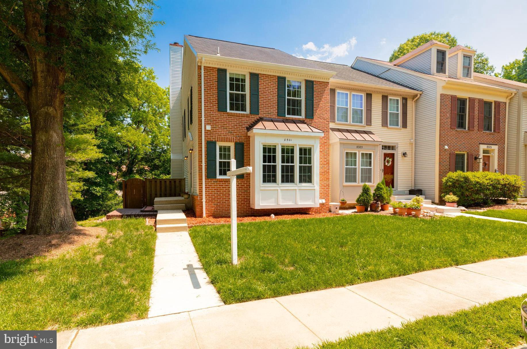 Immaculate end unit with peaceful wooded views, fenced yard with 2 decks, sunny walkout basement with fireplace, recessed lights, crown molding & a full bath, windows replaced & both sliders replaced with French doors, spacious master suite w/ 3 closets & vaulted ceilings, MBA w/ double sinks, siding replaced with vinyl siding & more! 2 assigned parking spaces # 963 & 955.