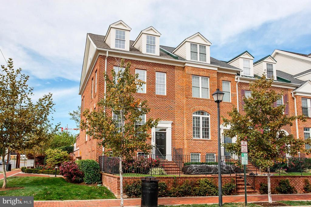 Fantastic, All Brick, End Unit townhome offers 3 BR, 3.5 BA and is located a block from local shops, restaurants and minutes to Amazon's New HQ2. The open floor plan has 2,200 sq. ft. of living space. The gourmet kitchen has lovely maple cabinets, granite countertops and a private patio perfect for outdoor entertaining! The lower level leads to the garage with 2 parking spaces. This Amazing location is a commuters dream just minutes to METRO, National Airport and Washington D.C.