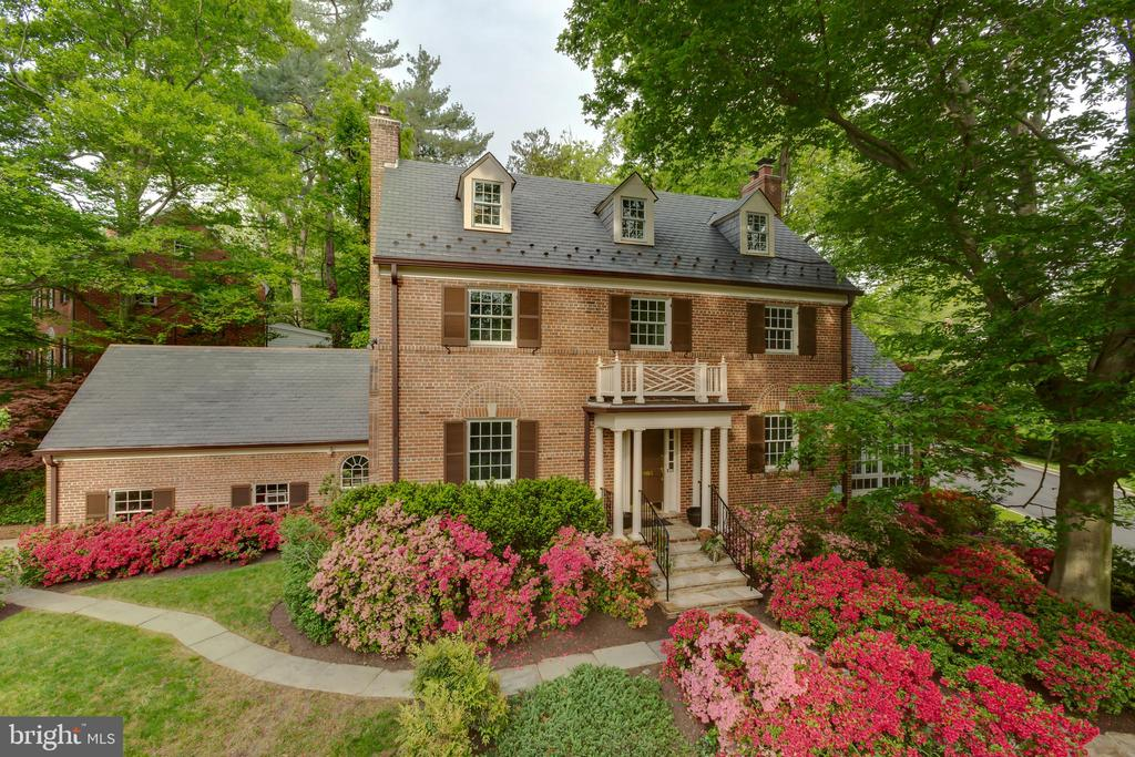 The timeless elegance of this lovely five-bedroom colonial in the leafy neighborhood of Forest Hills is a remarkable opportunity to own an exceptional residence at a compelling price. Recently revitalized with roughly 4,000 square feet of fine living, this home boasts a one-of-a-kind layout, with a welcoming foyer that is bookended by a warm dining room and double-length living room. A delightful conservatory boasts radiant stone-floor heating, incredible natural light, a double-sided fireplace and french doors which open to the private, backyard patio. There is so much more to see in this wonderful home - including a brand-new HVAC, fresh paint, new carpeting, new light fixtures and an oversized garage - but it is unlikely to last long at this price. Hurry to see it today, and call this masterpiece your own.
