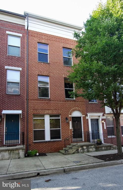 Check out this sold brick 3 level townhouse in the beautiful and quite tree-lined streets of Albemarle Square. Enjoy spacious room sizes, wall to wall carpet, large living & dining room, lovely kitchen with stainless steel appliances & granite counters that leads to deck overlooking rear yard, and attached garage at rear.  Master suite with built-in closets opens to second deck with nice view of the city. Master bath has dual vanity, bath  tub and separate shower.  Perfect location - a quick walk to Little Italy and Harbor East. Easy access to shopping, theaters, restaurants, transportation and commuter routes.