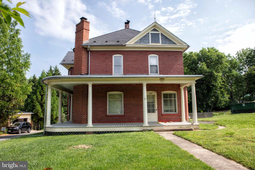 Charming brick house on large double lot, ready for an update!  House is solid and in great shape.  Nice double lot that backs up to Harpers Ferry Children's Park.  Interior photos will be coming soon!