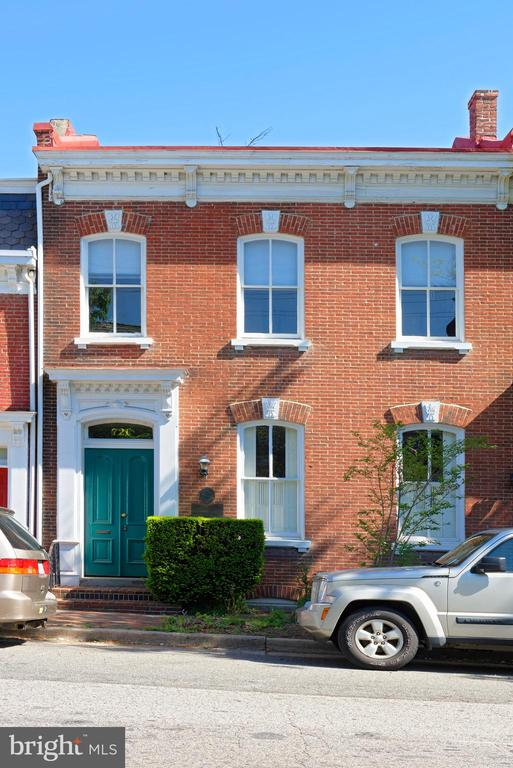 Historic brick townhouse currently used as office space for four tenants.  High ceilings, two fireplaces, original floors, and off street parking for four cars.  Historic plaqued building with 2,882 total sq. ft and large basement storage.  Appointment through listing agents only.