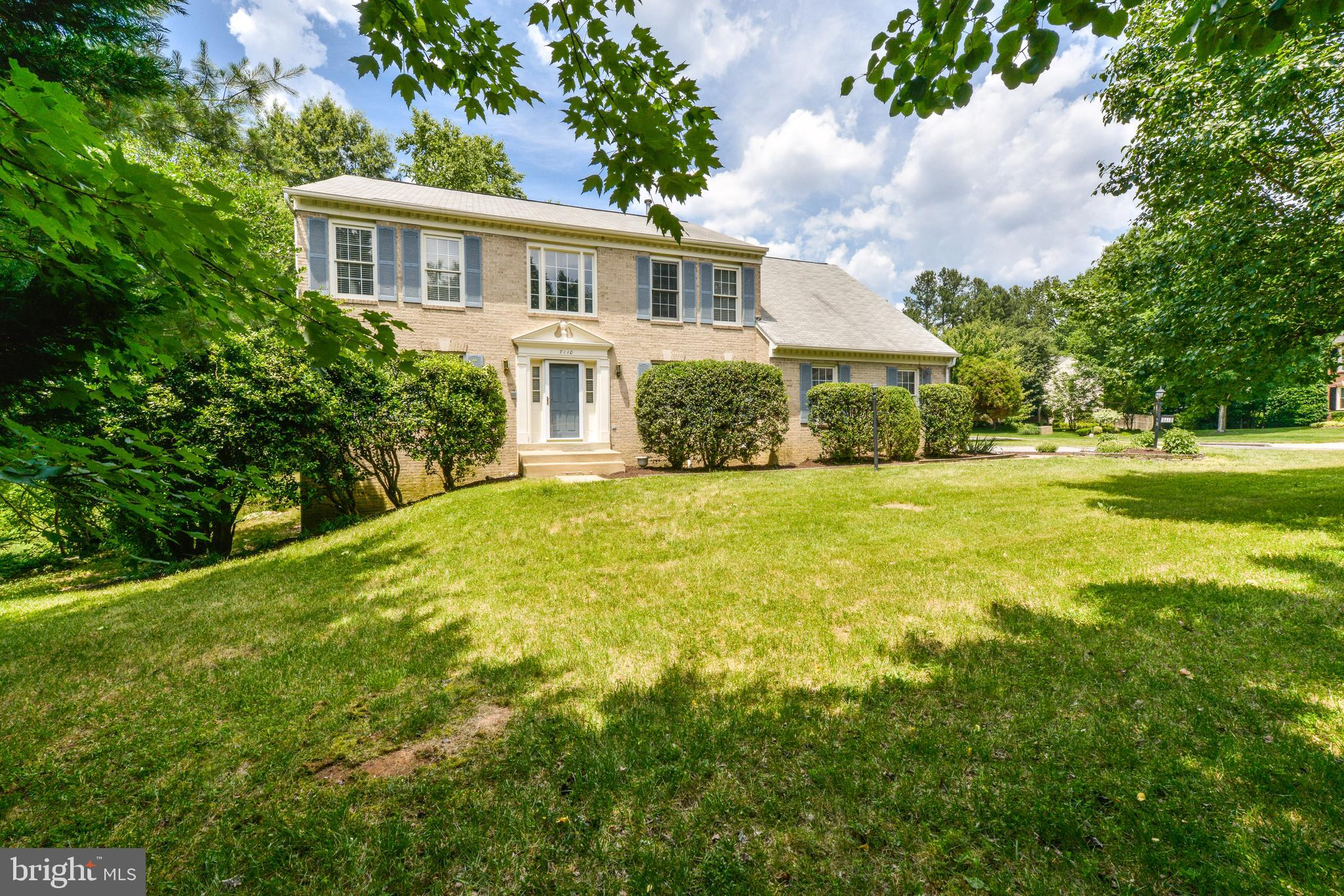 Get ready to be impressed! From the moment you pull into the driveway of this beautifully updated colonial Home.  Lovely details throughout the home include hardwood floors through the house except for the basement.  The beautiful kitchen features a center island, beautiful granite counters, and new SS appliances. The family room off the kitchen has a cozy gas fireplace & light-filled atmosphere. Master suite features an updated bath with dual vanity & ceramic tile shower.  Another great place to hang out is the finished walk-out basement with huge family entertainment space and 1 bedroom and Den with a full bath.  Relax & enjoy the outdoor space of a huge deck and mature natural trees.