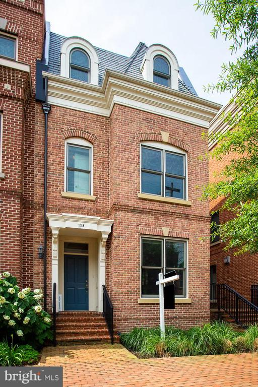 Old Town Luxury Living, just blocks from King St Metro, stroll to shopping and restaurants. Lovely, sun-filled end unit, windows galore, 3 bedroom suites, private patio, rooftop terrace, an open-floor plan, living room with fireplace. Light-filled kitchen with granite countertops and stainless appliances.  The top floor is a complete Master suite with a large bath, generous walk in closet and walkout to your terrace.  Your electric car can charge in one of your THREE GARAGE SPACES. You can't get any better than this!