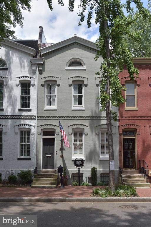 Don't miss the rare opportunity to own this stunning 4 BR   3.5 BA Victorian rowhome, built circa 1886, located on gorgeous Swann Street in the highly desired Logan Circle neighborhood. Nestled in the heart of it all, this home offers luxury and privacy within a short walk to endless dining, retail, fitness, grocery, and transportation options. Upon entry, you~ll be amazed by the eleven-foot-high ceilings; the brilliant natural light that floods the living and dining areas; and the dramatic, antique English black marble fireplace, featuring a Venetian plaster chimney. The custom-made white oak floating credenza, with its integrated lighting and black soapstone top, adds a finishing touch. The first floor~s open plan lets you take in the immense space this home offers. The gourmet kitchen features Viking appliances, a Miele knock-to-open dishwasher, Tom and Flos Light fixtures, wine refrigerator, custom mahogany cabinets, and exotic marble countertops. A concealed breakfast nook overlooks the ground-floor deck and bucolic private patio, which are perfect for entertaining. Fully renovated in 2017 by Fowlkes Studio, the second floor includes a spacious central media room; two bedrooms with generous storage provided by custom-built cabinetry; and a full bathroom. The third-floor master suite boasts a half-moon window; the expansive adjoining spa bathroom has Venetian plaster walls and handmade Waterworks-tile shower with Kallista fixtures. Ample storage is provided by 8.5-foot custom wardrobes with leather pulls; the nursery, featuring Oscar de la Renta wall coverings, can also be used as a walk-in closet. Completing this oasis is the private roof deck, perfect for yoga or your morning coffee. (Permits have been submitted for an addition to the roof deck, which will expand this space even further.) The lower level is perfect for additional living space, or as a guest, in-law, or au pair suite. Entered from the interior or private outside entry, this level has a full kit