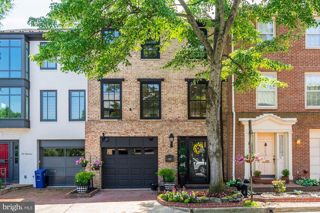 Welcome to 102 Quay St, where timeless elegance meets Old Town Charm. Located across from Founders Park/Alexandria City marina this updated town home offers privacy and peace yet close to the restaurants and shopping Old Town offers. This magnificent town home features garage parking, marble floor entry, great living room with gas fireplace, gorgeous hardwood floors, lighted built ins and access to water view back garden. Completely well thought kitchen with smart appliance, silestone counters, warming drawer and is set up for the chefs to work side by side while entertaining their guest. Carefully mastered, master suite has double entry walk through closet, plus one and spa like bath with walk in shower. Upper level bedroom offers two closets, water views from window seat and beautiful bath with separate claw foot tub and seamless glass shower, water closet and double sinks. Lower level media room with built in wine refrigerator, custom laundry area and plenty of storage. Don~t forget the rooftop access for your future terrace. This well thought out home, has all the custom touches in place. Close to Amazon new headquarters Just turn the key and enjoy