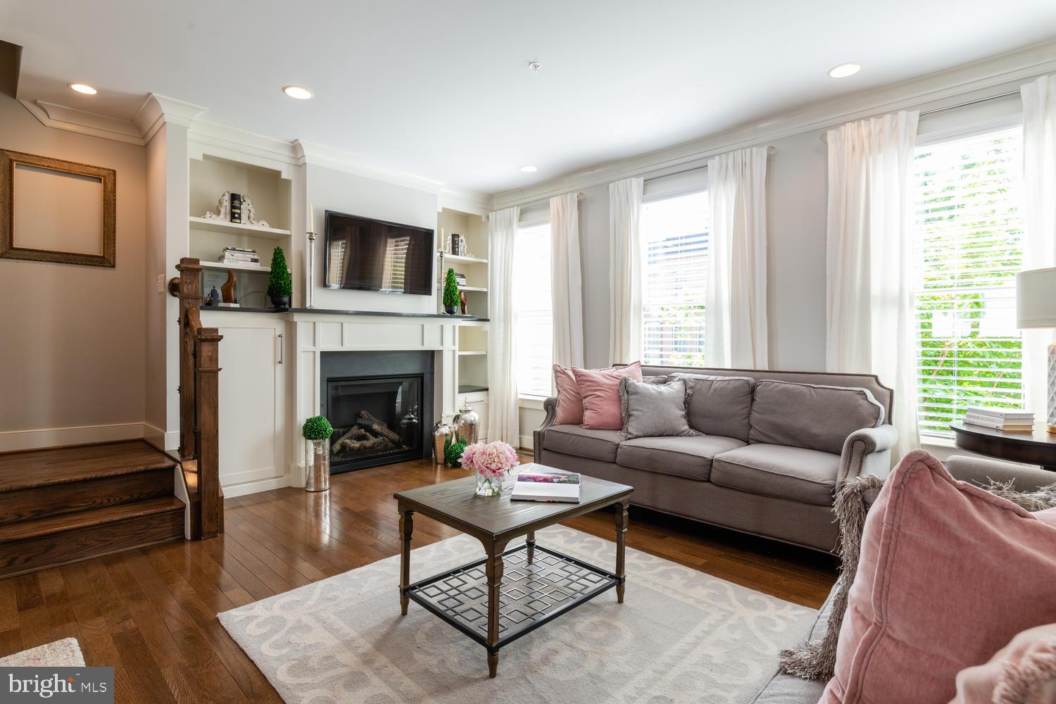 This beautiful townhouse located in the heart of Old Town Alexandria is steps from Braddock Road metro, National Landing (Amazon HQ2), Reagan National Airport, and many new restaurants.  Located in the sought-after community of Old Town Commons, 921 North Alfred Street is a luxury 3 bedroom/3.5 bath townhouse that features traditional architecture with modern design elements. This home offers a 2-car garage, ample storage, two outdoor entertaining spaces, and two separate flexible indoor spaces. All three bedrooms feature ensuite bathrooms. High-end finishes and thoughtful details throughout make this a one-of-a-kind home. Offers are Due Tuesday 6/4 at noon.