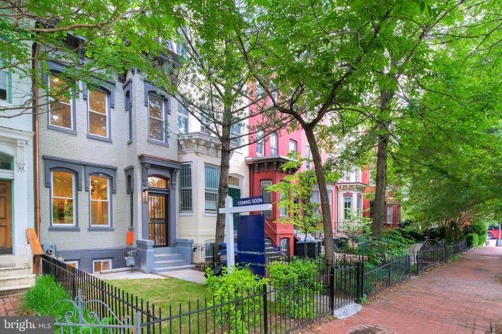 Steps from picturesque Logan Circle, on a leafy block, this renovated 6 Bed/4.5 Bath Victorian row home finds balance between a bygone era and modern life. Set over four floors, the home maintains a more traditional floor plan, with gentle separation between the main level living room, dining room with wet bar, and gourmet kitchen, boasting stainless steel KitchenAid appliance suite, quartz countertops, and access to a private patio. The second level features three bedrooms and two baths, including the master bedroom with ensuite bath and walk-in closet, while the top floor boasts an additional two bedrooms, and bath. The fully finished basement, with separate front and rear entries features one more bedroom, bath, sitting room, and large storage space. All this within walking distance to the countless amenities of 14th Street, U Street, and Shaw, including myriad bars, restaurants, and shops; plus a dog park, Whole Foods, and Trader Joe's! Seller will cover two nearby, off-street rented parking spaces for one year.