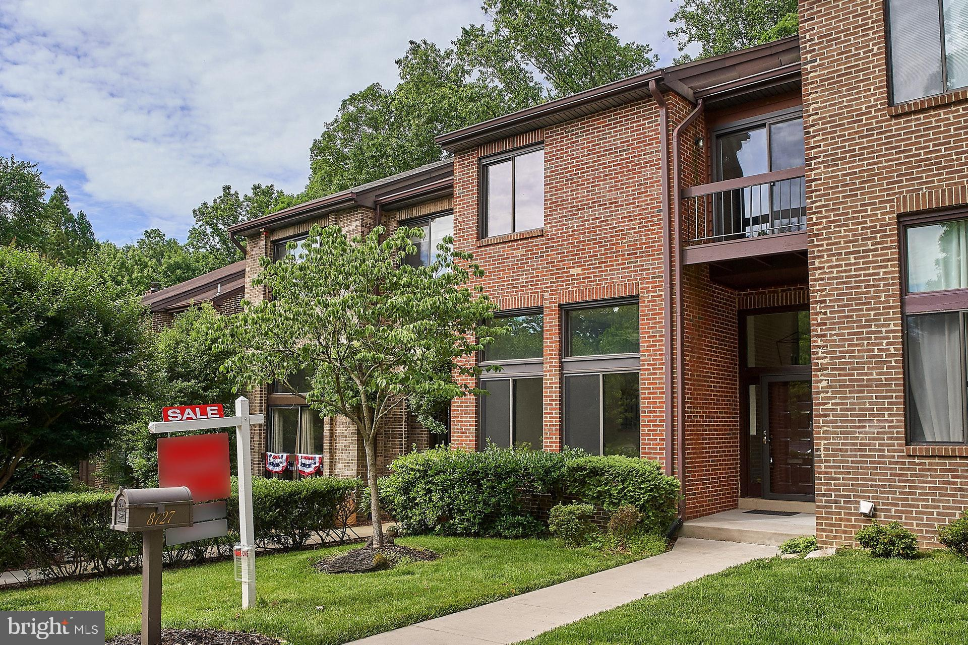 Stunning 5-level all-brick townhome tucked away in back of neighborhood on non-thru street backing to woods*Updates galore*New carpet, fresh paint thruout*Sun-drenched rooms*Spacious living room with volume ceiling*Separate dining room*Updated eat-in kitchen with new LG Hi-Macs counters, updated appliances, wine fridge, new flooring and doors to deck overlooking wooded parkland*Generous-sized bedrooms*Master bedroom has walk-in closet plus remodeled bathroom with large, walk-in shower and secluded deck for morning coffee overlooking nature*Laundry on bedroom level*Walkout rec room with gas fireplace and full bath*Unfinished basement great for storage*Two assigned parking spaces + ample guest spaces*Conversion to gas heat/cooking*Close to shopping, eateries, mass transit and more